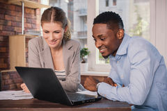 Two business people working together Stock Images