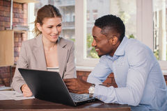 Two business people working together Stock Photo