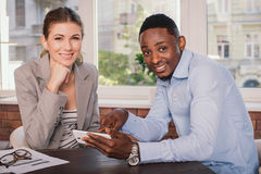 Two business people working together Stock Image