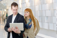 Two  business people working together with a laptop Stock Photo