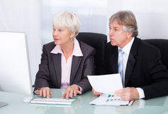 Two Business People Working Together Royalty Free Stock Photography