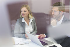 Two business peoples working together in meeting room Stock Photo
