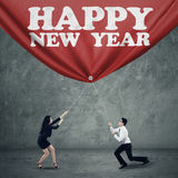 Two business person drag new year banner Royalty Free Stock Images