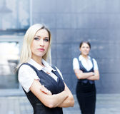 Two business persons in formal clothes Stock Photos