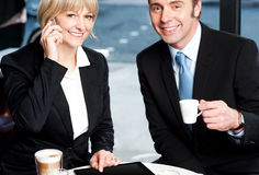 Two business professionals at coffee shop Stock Photos