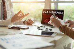 Two business talking about agreement car insurance contract. Royalty Free Stock Photography