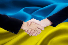Two business team with Ukraine flag Stock Photos
