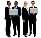 Two business teams posing with laptop. Over white background Stock Images