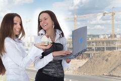 Two business woman advertises real estate stock photos