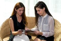 Two Business woman. Two Asian Business Woman Talking, Dealing and Signing Contract Stock Photography