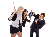 Two the business woman beat the man folders Stock Photography