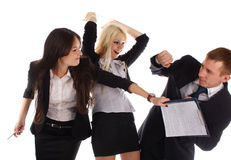 Two the business woman beat the man folders Royalty Free Stock Image