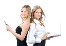 Two business woman with ebook and laptop Stock Images
