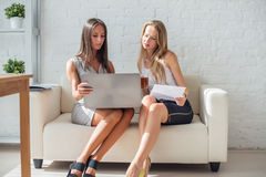 Two business woman friendly discussion during Stock Images