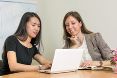Two business woman sitting by the computer Stock Images
