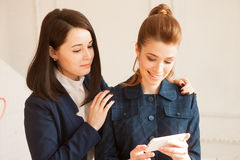 Two business woman with smartphone Royalty Free Stock Image
