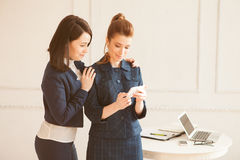 Two business woman with smartphone Stock Photos