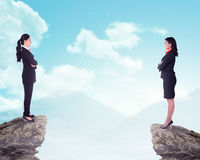 Two business woman standing on the top of the mountain Royalty Free Stock Photography