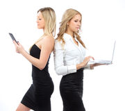 Two business woman with tablet and laptop Stock Photos