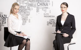 Two business woman on a white background. Royalty Free Stock Image