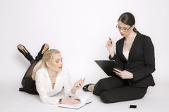 Two business woman on a white background. Stock Images
