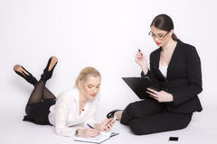 Two business woman on a white background. Stock Photos