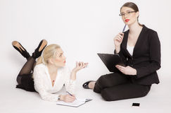 Two business woman on a white background. Royalty Free Stock Photography