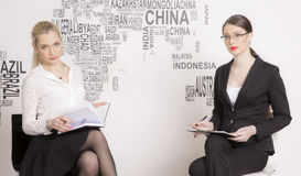 Two business woman on a white background. Stock Photo