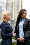 Two Business Women. In city stock photos