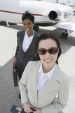 Two Business Women At Airfield Royalty Free Stock Image