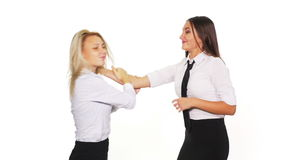 Two business women arguing and getting into a fight - studio shot. Two business women arguing and getting into a fight stock video footage
