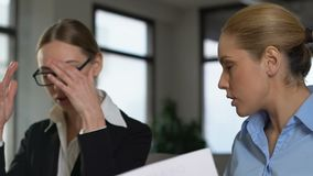 Two business women arguing in office, colleagues misunderstanding, work stress. Stock footage stock video footage