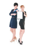 Two business women with blank. Two business women  holding blank in hands. over white background Royalty Free Stock Images