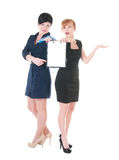 Two business women with blank. Two business women  holding blank in hands. over white background Stock Photography
