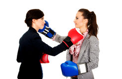Two business women with boxing gloves fighting. Royalty Free Stock Image