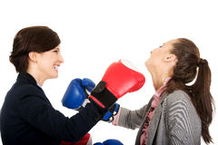 Two business women with boxing gloves fighting. Stock Photo