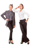 Two business  women in casual poses Royalty Free Stock Photo