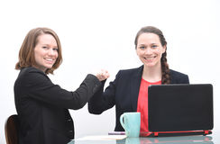 Two business women doing fist bump Stock Photography