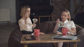 Two business women eating dessert and speaking. In the cafe stock footage