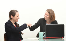Two business women and fist bump Royalty Free Stock Photography