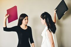 Two business women have conflicts in the workplace, they are hit royalty free stock images
