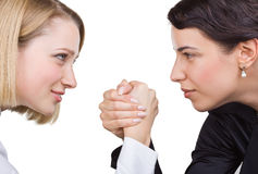 Two business women look at each other's eyes Royalty Free Stock Photos