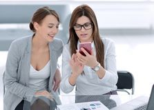 Two business women looking at the smartphone screen. Business and technology stock photography