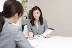 Working Asian business women stock photography