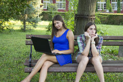 Two business women in the park to buy a laptop Stock Images
