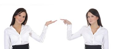 Two business women are pointing at each other Royalty Free Stock Photography