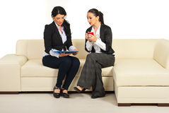 Two business women reading papers Stock Images