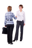Two business women shaking hands royalty free stock photography