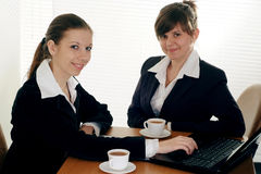 Two business women sitting Royalty Free Stock Photos