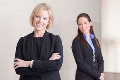 Two business women standing in hallway Royalty Free Stock Photos